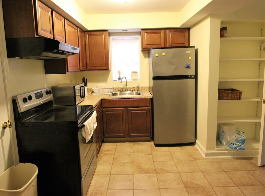 Full size stove and fridge; counter microwave.