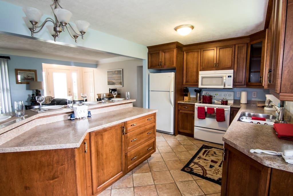 Bright, Open, Fully Equipped Kitchen With Dine-at Island