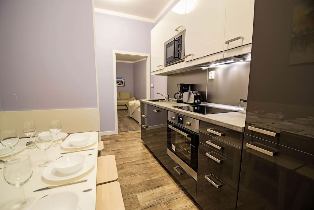 Our kitchen is fully equipped  with toaster, microwave oven, fridge, oven, stove