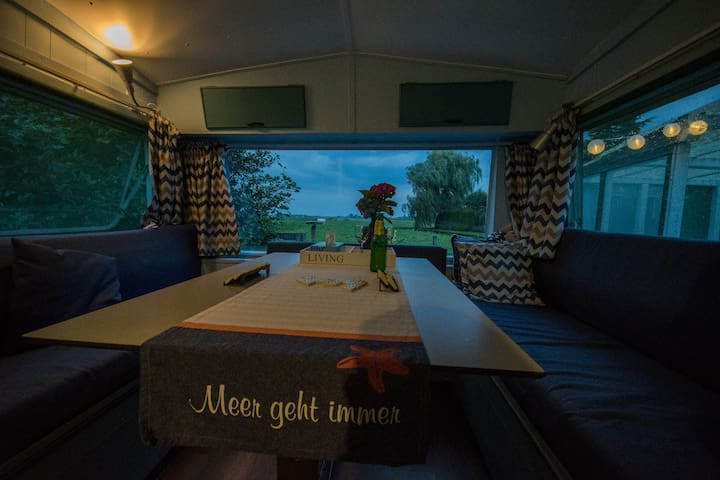 Our inside caravan view at cloudy afternoon, Guest play gameboard  provided in our caravan. Photo credit by our lovely guest Patrick Bieniek