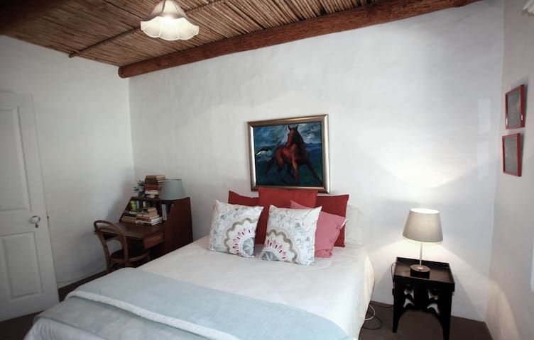 The second bedroom with crisp white linen
