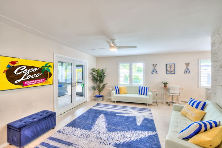 Our nautical living room has 2 futons & a desk for you to get some work done!