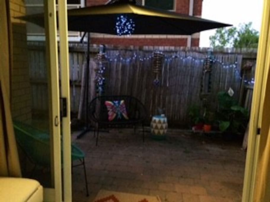 Outdoor area. Grassy backyard and  full kitchen as well.