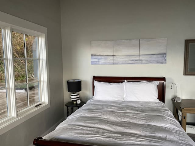 Queen size bed in upstairs bedroom