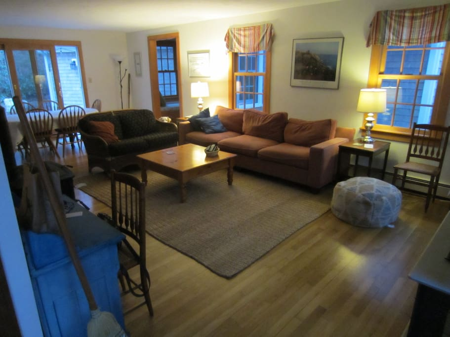 Living/Dining area with TV and woodstove