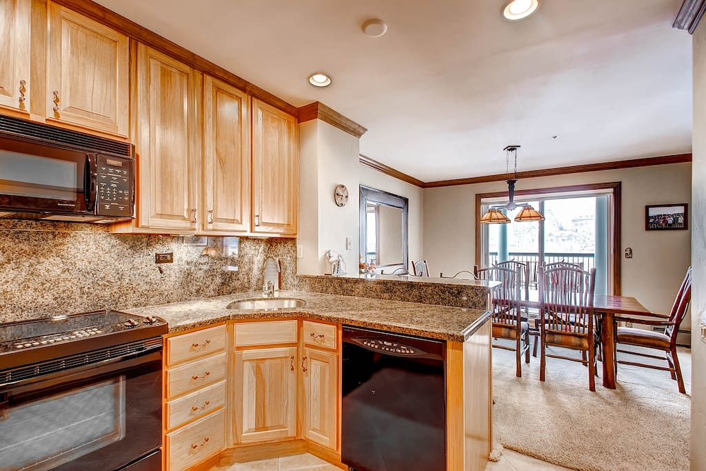 Open Kitchen with Granite Table Top