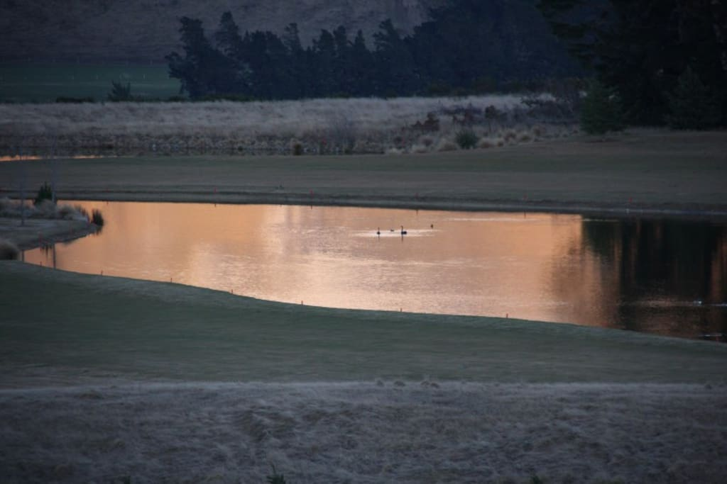 Sunrise reflecting in a lake on the Golf Course seen from balcony of Villa 231.