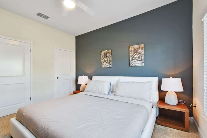 This first floor bedroom offers a king-size bed,dresser, flat screen HDTV, closet space and an adjacent bathroom. Relax on this vacation and enjoy all this home has to offer.