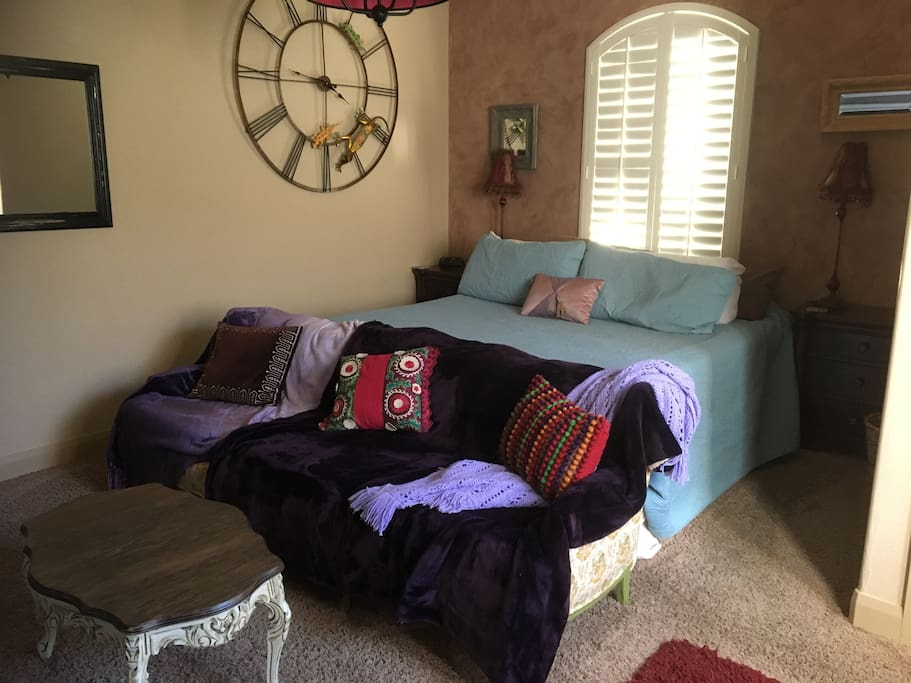 Comfy continental king size bed and vintage lounging sofa .