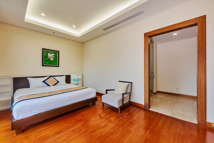 2nd ensuites bedroom with pool and garden view
