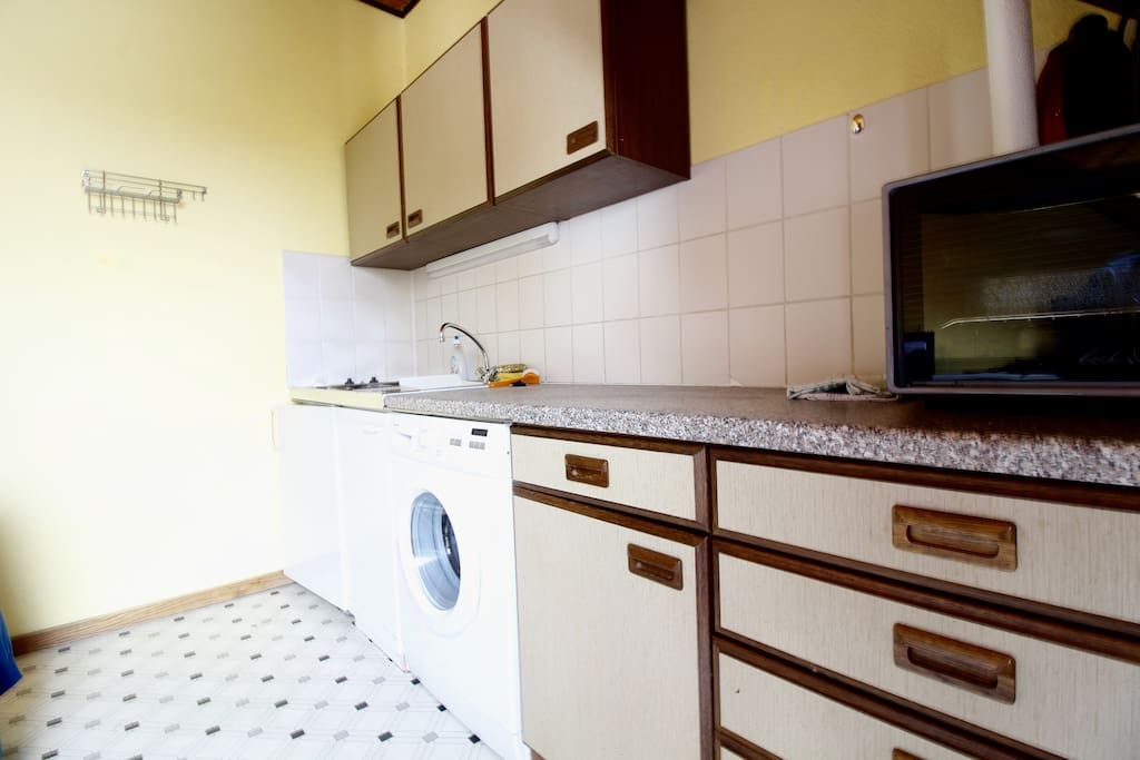 The fully equipped kitchen offers everything you need.