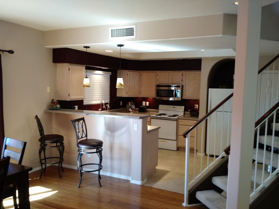 Spacious kitchen with bar