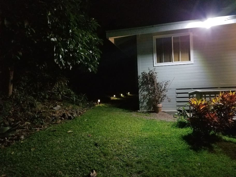 Outside entrance with sensor light and solar path lights