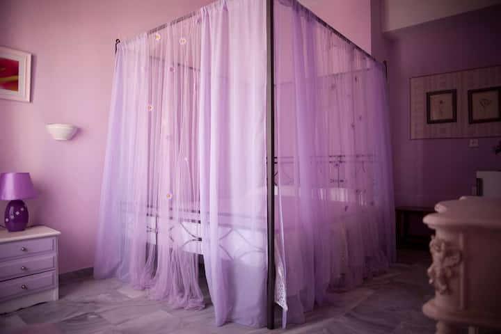 """Violet"" room at the Jasmine Collection"
