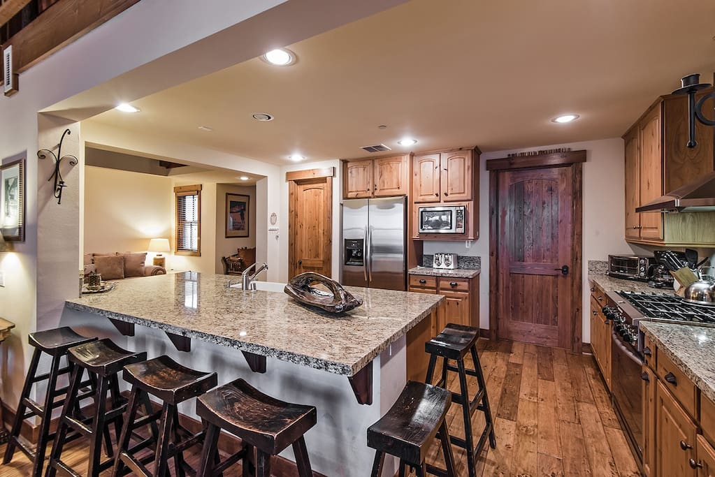 Large cooks kitchen that can fit a crowd and allow you to make large meals at home.