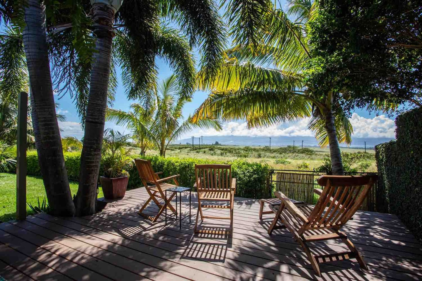 This is the view from your private Lanai . From here you can see the west Maui mountains all the way to Paia bay and beyond. We have since updated the furniture with teak table and two chairs with Tropical comfortable cushions. This view is enormous!
