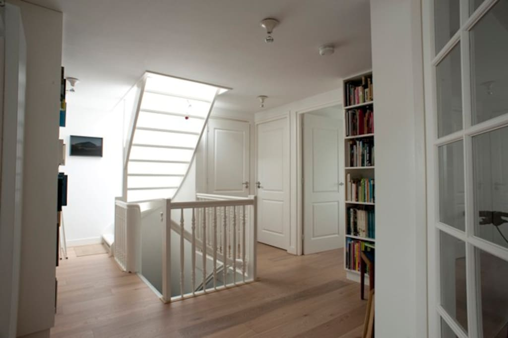 Hal and staircase with own library