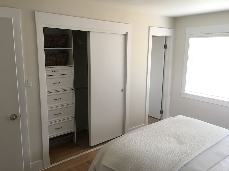 Spacious closet with built in storage.