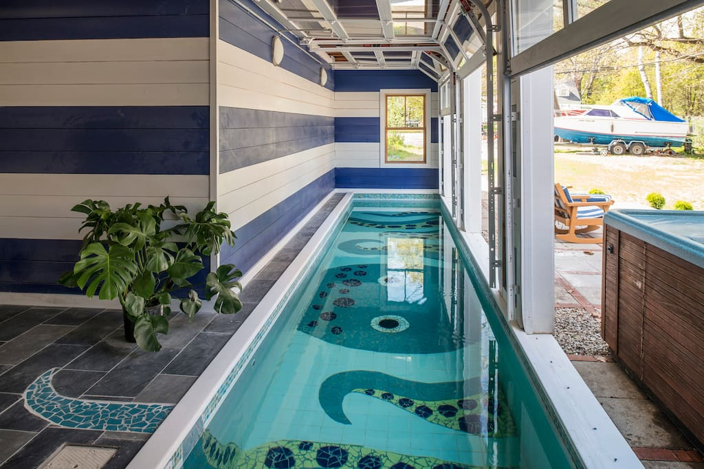34' lap pool with 3 glass doors opening to outdoor patio