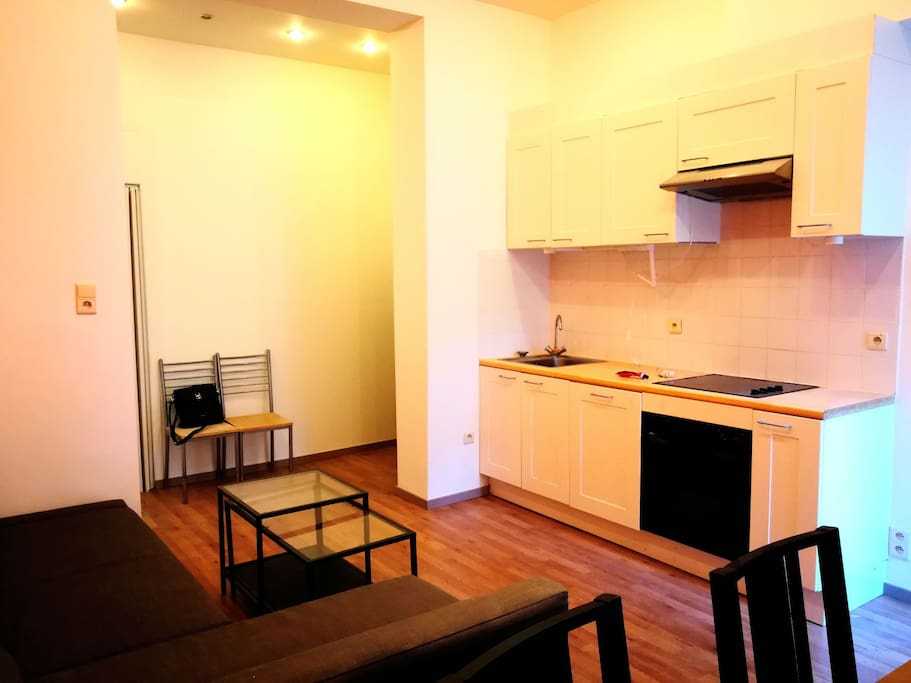 sofa bed & equipped kitchen