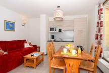 Relax in the gorgeous open-concept living space which adjoins with the fitted kitchenette.