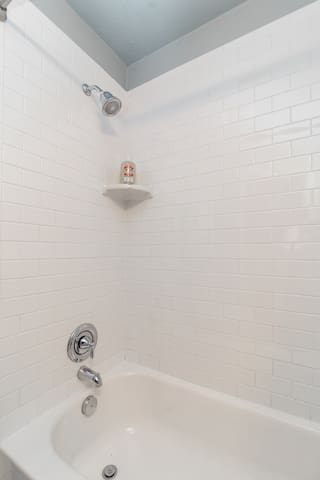 Recently refreshed bathroom includes white subway tile.