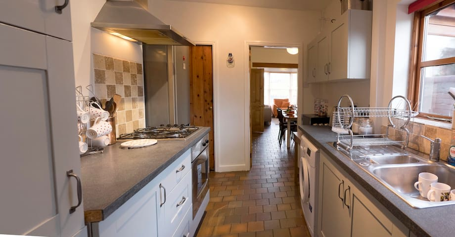 Kitchen, with fridge and freezer, electric oven and gas hob. Fully equipped with cutlery, crockery and cooking equipment.