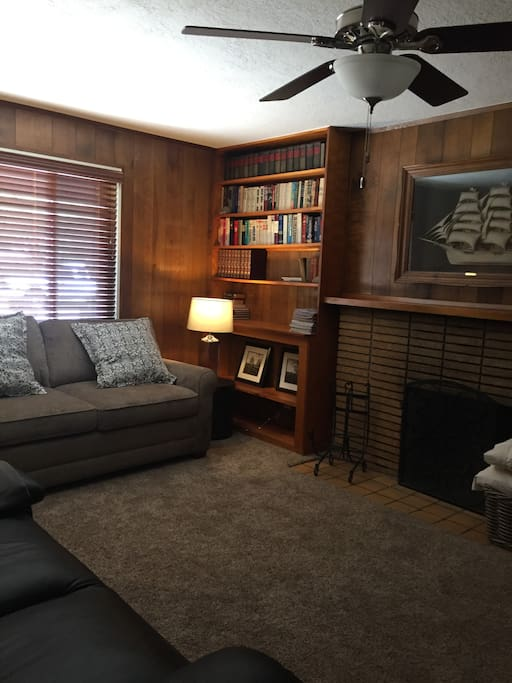 Den with fireplace, sofa bed  for two & leather couch.