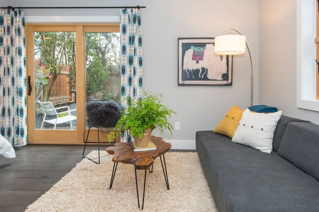 Studio space that overlooks the garden, fir wood windows add a little warmth to the modern aesthetic.