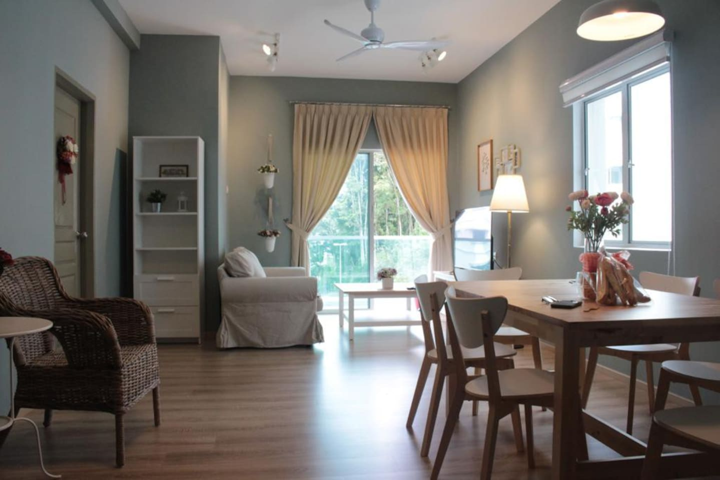 "Spacious Living Room with 50"" Smart TV & Balcony"