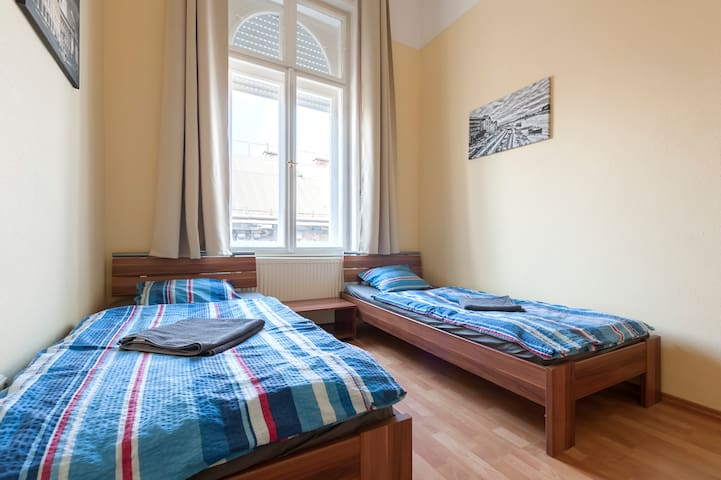 Bedroom 2 has got two comfortable single beds.  The Apartment is in a typical Budapest residential building.