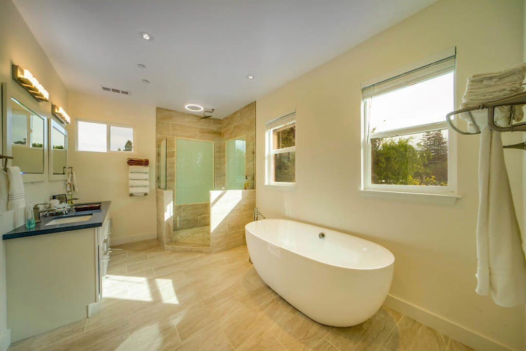 Oversized spa soaking tub and walk in shower with rain head.
