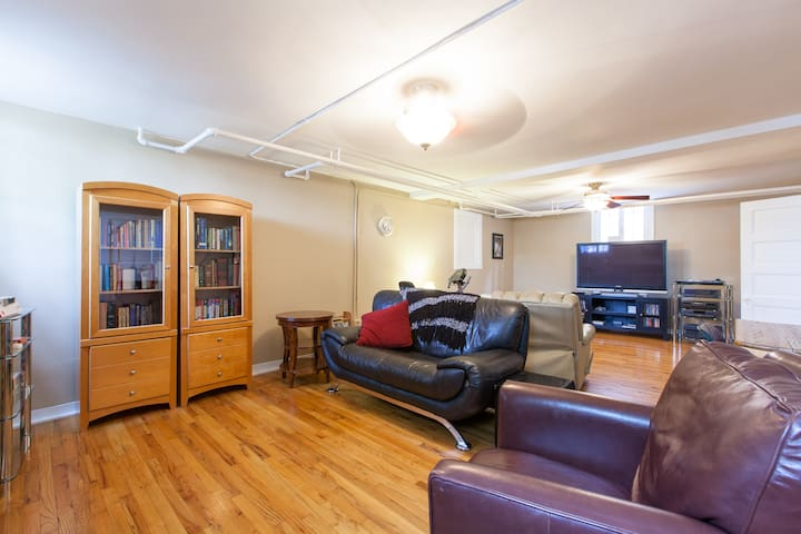 Family room with large TV, Roku and DVD player.