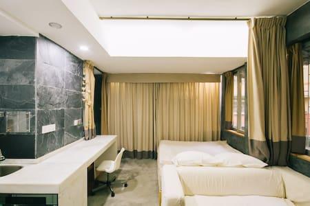 步行至江南西地铁站仅5分钟,方便搭高铁,安静花园小区,简约现代居室 - Guangzhou