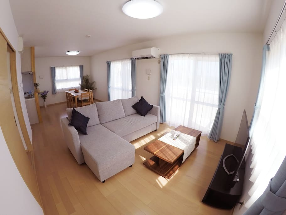 Large living room area is on the second floor, with a large sofa bed.