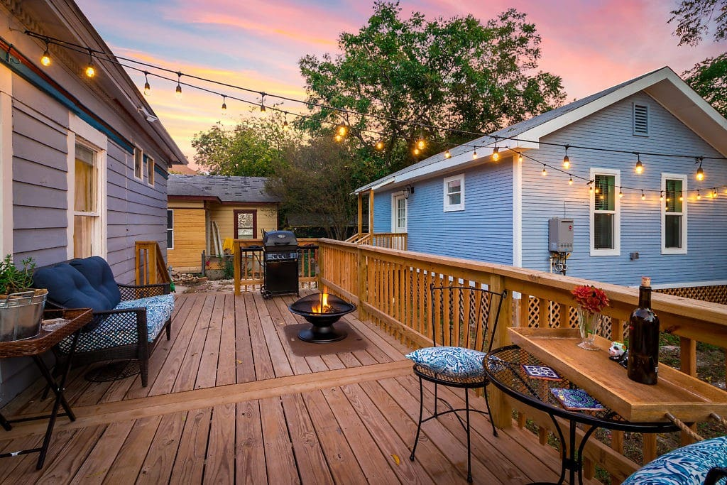 Back Deck with Fire-Pit, Propane Grill, outdoor seating and outdoor lighting.