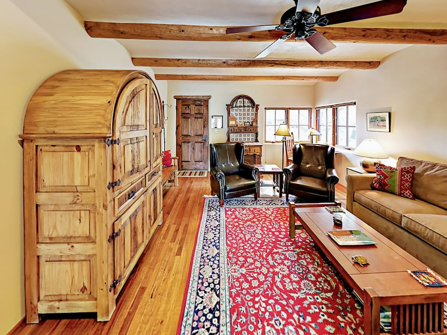 """Gorgeous pinewood armoire housing a 32"""" flat screen TV.  Complimentary Wi-Fi included."""