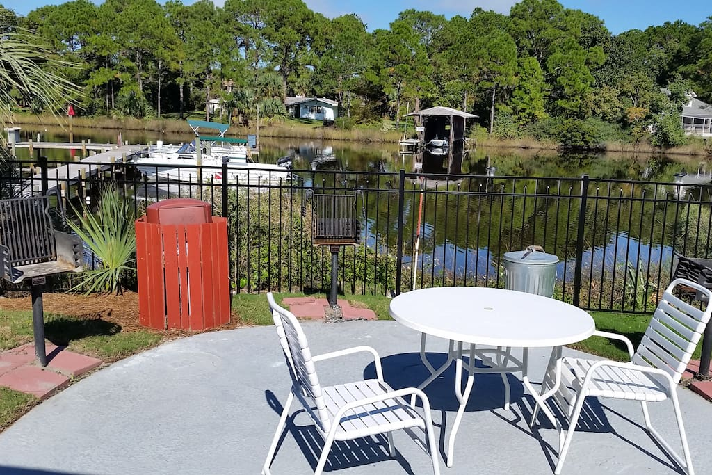 Grounds with outdoor grills and boat dock available.