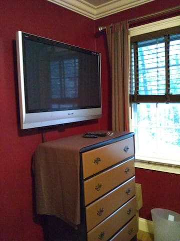 Flat screen TV, watch from bed.