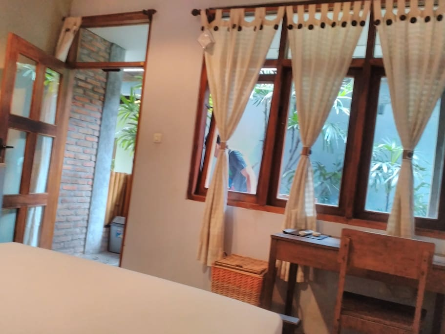 Room Dieng facing out door  with greenery view in front and at side