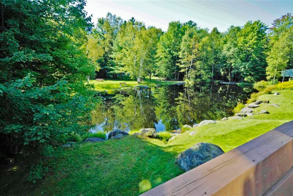 Look forward to lounging on the large deck overlooking the pond.