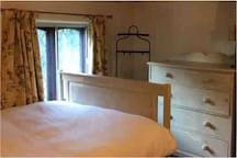 Beautiful cosy double bedroom with drawers and hanging space