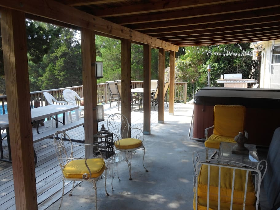 Patio deck - open, shaded and covered roof, plenty of seating. Fun lighting.