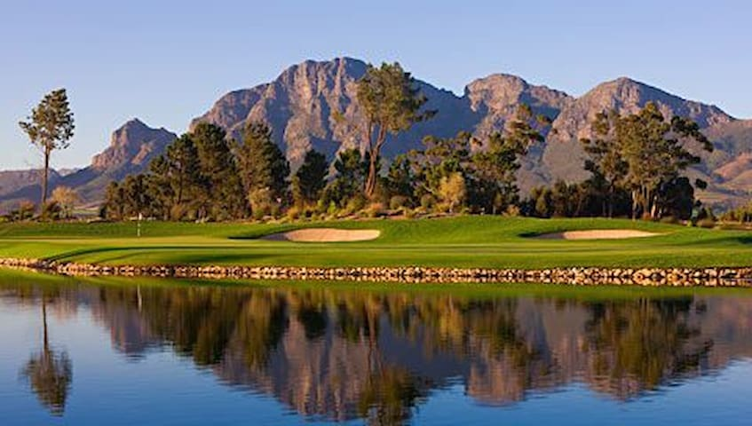 Beautiful 18 hole golf course, tennis courts, pool and spa at the clubhouse.