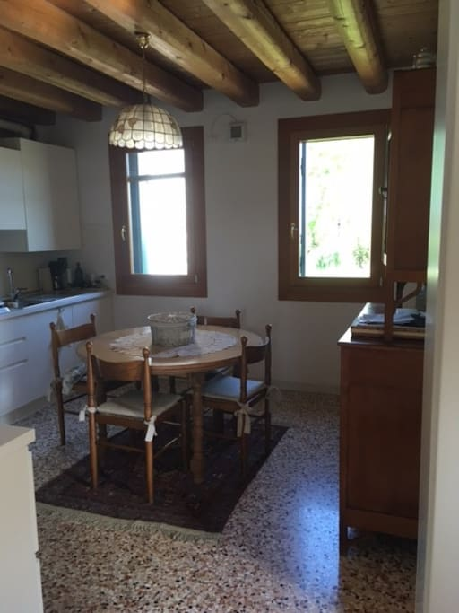 Kitchen with a round table for 6-8 people