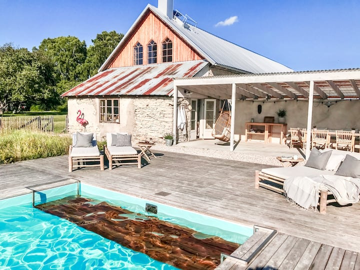 Unique living in modernized old barn with pool