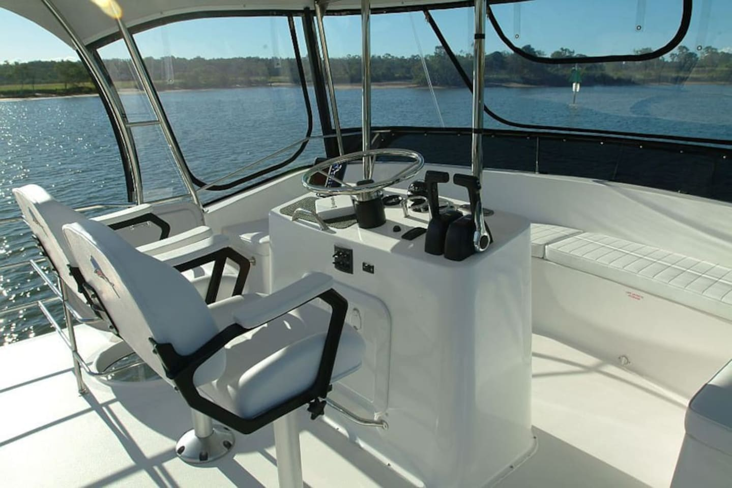 Top deck helm area, the perfect place to sit and enjoy the water view, glass of wine in hand.