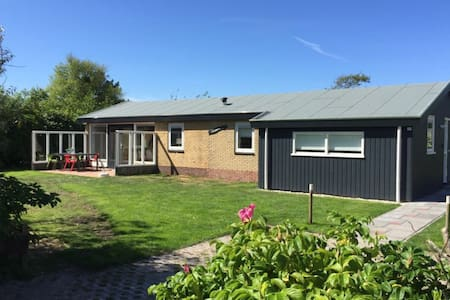 Detached bungalow, situated directly at a large sand dunes and nature area