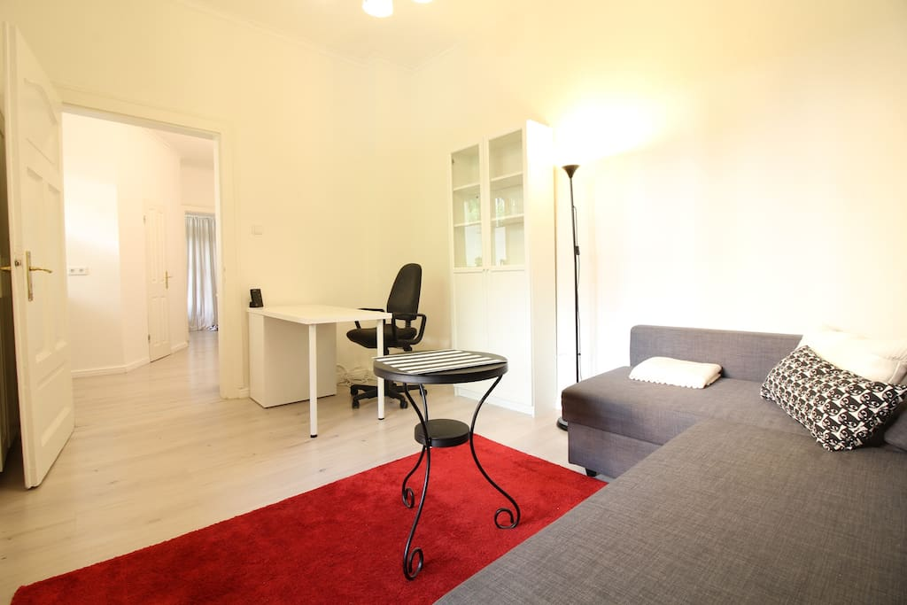 In the combined living and sleeping area you will find a cozy sofa bed, a TV and a desk.