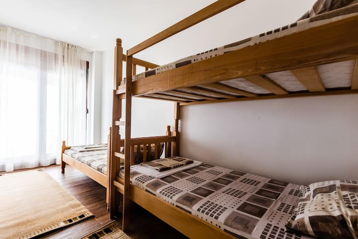 For those who prefer to sleep separately, we have a room with a single and a bunk bed on the first floor.